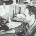 Chris at his desk